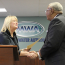 Judge Harris (left) congratulates Sam Hart after swearing him in as Chairman of the Macon Water Authority.