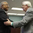 Dr. Kirby Godsey (right) congratulates Chairman Sam Hart after his swearing in as Chairman of the Macon Water Authority.