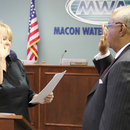 New MWA Chairman Sam Hart (right) is sworn into office by Sarah S. Harris, Judge Probate for Macon-Bibb County.