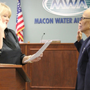 "MWA District 1 Board Member Dorothy ""Dot"" Black (right) is sworn into office by Judge Sarah Harris."