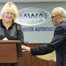 Signatures make it official after Dorothy Black is sworn into office again as District 1 Member of the Macon Water Authority.