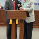 Former MWA Chairman Dr. Kirby Godsey (right) passes the gavel to Chairman Sam Hart, following his swearing in prior to the January Board Meeting.
