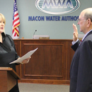 Frank Patterson (right), District 4 Board Member and Vice-Chairman of the Macon Water Authority, is sworn into office.