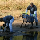 Jim Spry (left) and Brad Hayes clean up a portion of the river during the 2011 Ocmulgee Alive!