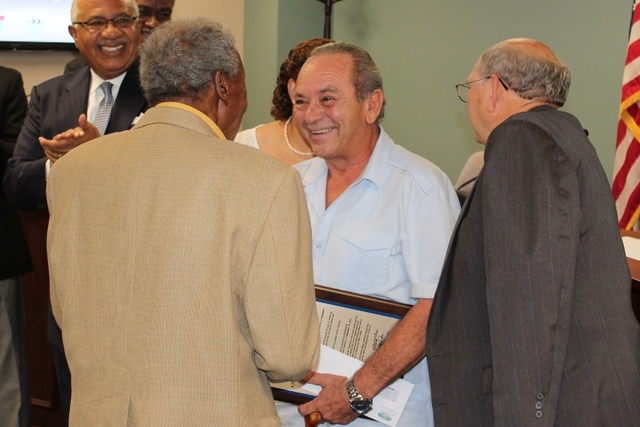 Alfredo Daniel receives congratulations from MWA Board Members, including Javors Lucas (left) and Frank Patterson (right).
