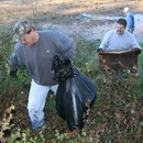 Jim Spry (left) and Lee Smith remove debris from the Ocmulgee River during the 2011 river cleanup.