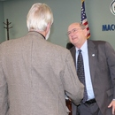 MWA Vice-Chairman Frank Patterson congratulates Ralph Hardy upon his retirement after 49 years with the Authority.