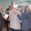 MWA Board Member Javors Lucas and other Board Members congratulate Mr. Hardy upon his retirement.