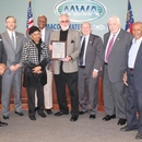 Ralph Hardy (center) receives a resolution honoring his 49 years of service to the MWA.