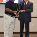 Zieburtz presents the Plant of the Year Award for the Amerson Water Plant to MWA Director of Water Operations Gary McCoy.