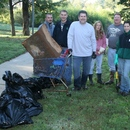 A group from YKK collects several bags, a shopping cart, and other debris from the river during the 2011 cleanup, Ocmulgee Alive!