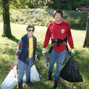 Paula Davis (left), with the Georgia Wilderness Society, and Edward Weintraut, the associate dean of the College of Liberal Arts at Mercer University, collect bags of trash and debris during the 2011 Ocmulgee Alive! river cleanup.