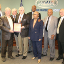 Randy Smith (second from left) is congratulated by the MWA Board and Executive Director Tony Rojas (far left).