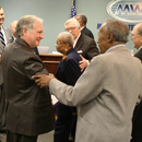 Randy Smith receives congratulations from MWA Board Member Javors Lucas and the other members of the Authority.
