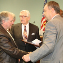 Randy Smith (left) chats with MWA Chairman Kirby Godsey (center) and Executive Director Tony Rojas (right).