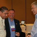 The Authority's Michel Wanna (left) and Mark Cloutier (center) chat during the 2013 GAWP Spring Conference.