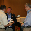 The Authority's Mark Cloutier (center) chats with fellow MWA employee Michel Wanna (left) during the 2013 GAWP Spring Conference.