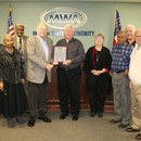 Herman Wilburn (center) receives a proclamation in his honor from the MWA Board at the January meeting, which was held 31 years to the day he joined the Authority.