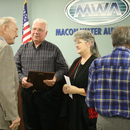 Herman Wilburn and his wife Peggy receive congratulations from MWA Chairman Frank Amerson (left) and Javors Lucas (right).