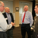 Macon Water Authority Deputy Executive Director Ray Shell (far left) and Director of Finance Guy Boyle (far right) chat with other water professionals prior to the GAWP Legislative Preview luncheon.