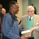 Solomon Mims (left) is congratulated by MWA Chairman Kirby Godsey upon his retirement.